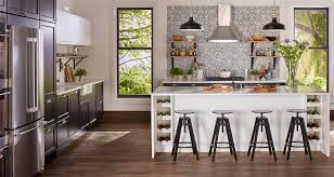 ikea kitchen designs. a kitchen featuring dark cabinets and white countertop. ikea designs
