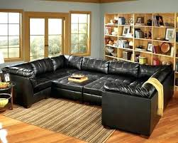 oversized sectional couch oversized sectional sofas couches sectional sofas light brown bookshelf u shaped dark sofa striped carpet many oversized
