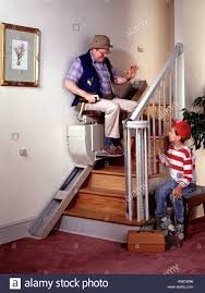 chair for stairs. Grandfather Young Boy Chair Stair Lift Handicap - Stock Image For Stairs A