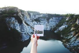 picture of someone holding a vacation picture