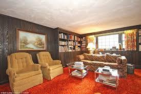 orange is the new brown the orange carpet in the 21sqft living room screams