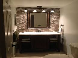 traditional bathroom lighting ideas white free standin. Traditional Bathroom Lighting Ideas Faucet Under The Large Rectangle Mirror Black Wall Tile Frame Brown Laminated Wooden Floor White Ceramic Toilet Free Standin N