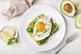 avocado toast with an over easy egg