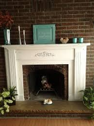 a beautiful fireplace mantel using annie sloan s chalk paint pure white distressed