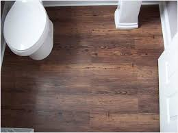 grey wood effect vinyl flooring comfortable wood floors vs porcelain tile more eye catching teatro paraguay