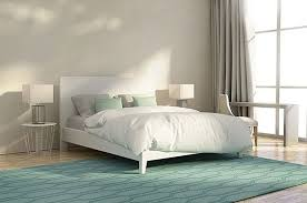 this luxury abstract bedroom has a splash of color with the designed green area rug this adds some flare to the bedroom
