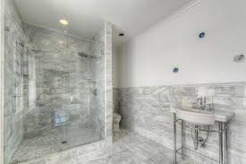 gray bathroom. transitional 3/4 bathroom with complex marble tile floors, frameless shower doors, handheld gray