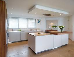drop lighting for kitchen. the drop ceiling creates a flush fit extractor above central bulthaup b3 island lighting for kitchen