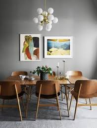 dining room idea with colorful framed pictures large wood table and grey walls