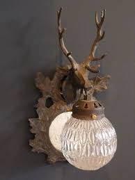 stag wall lights with globes