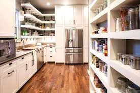 extra kitchen storage design group created this super pantry with extra appliances plenty of shelving and