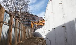 mitrovica kosovo bulldozers demolish a wall in this ethnically divided town following weeks