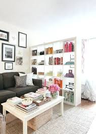 small coffee tables for apartments small apartment room with bookcase room divider and white coffee table