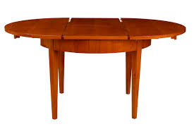 round dining table in viennese biedermeier style with 4 tapered legs extendable with curved veneered floor plate with round glue laminated veneered frame