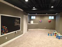 painted basement ceiling - white instead of black. Like the simple recessed  lighting. Like the wall color, baseboards and molding