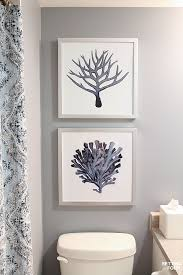 to hang pictures in a bathroom