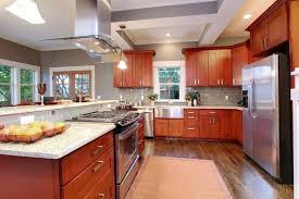 cherry cabinets with white quartz countertops