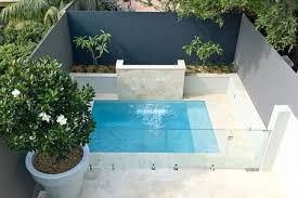 a mini pool is created in a small backyard space