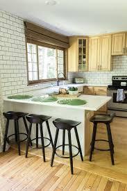 modern kitchen with wood cabinets and subway tile backsplash