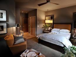 bedroom master color scheme brown wooden bed having blue blanket bedding purple table lamp grey sofa