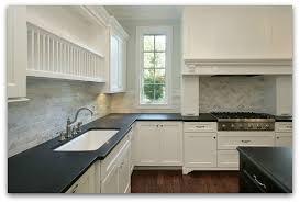 black kitchen cabinets and granite countertops photo 13