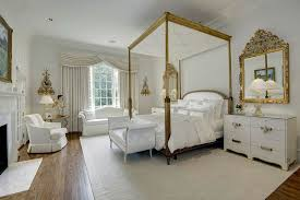 white theme french style bedroom with four poster bed in gold with white bed seat and