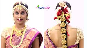 por south indian bridal makeup video bridal hairstyle with traditional bridal accessories