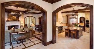 The arched doorway in this home features a knotty alder wood casing that  has been stained and finished with a gel glaze.