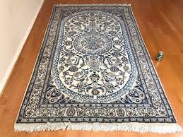 hand knotted persian wool area rug made in iran blue light brown cream 8 6