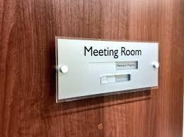 Sliding Door Signs Meeting In Progress Or Vacant Boardroom