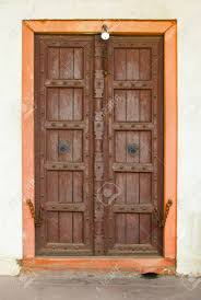 stock photo the old wooden door on a building facade india agra