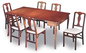 traditional wood dining tables. this traditionally styled, natural stained wood dining table features the aesthetic and utilitarian addition of a pair drawers beneath surface. traditional tables t