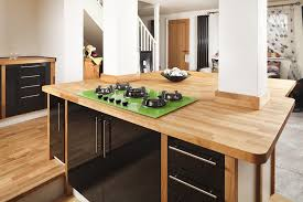 matching solid oak upstands protect the columns which divide this wooden kitchen island