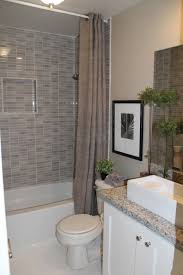 Modern Small Bathroom With White Bathtub And Glass Door Shower ...