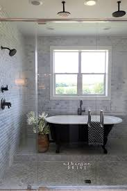 V This Master Bathroom Has A Giant Wet Area Covered In Marble Tiles With Four  Shower Heads And Vintageinspired Clawfoot Tub