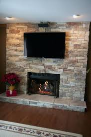 smlf ledge stone fireplace located lake installed brick install tv above wood burning can you put a