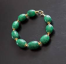 bracelet in large polished emeralds 242 ct total length 22 9 cm