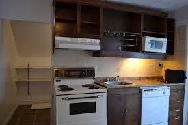 functional mini kitchens small space kitchen unit: avanti mini kitchen kitchen charming brown compact kitchen design with wood rack and white kitchen appliances
