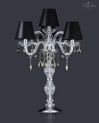 crystal table lamp with four lamps and chrome metal finish decorated with crystal swarovski elements color and lampshades in pvc black chrome