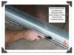 use a wire brush to clean the screen door track