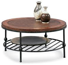 round cocktail table with faux leather top and metal base