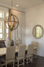 view bench rope lighting. currey u0026 co axel orb chandelier over salvaged wood trestle dining table surrounded by gray wingback bench and french square back chairs framed view rope lighting o