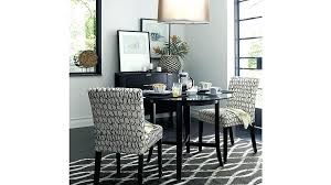 breathtaking crate and barrel dining room table halo ebony round with glass top reviews pumpkin tablecloth