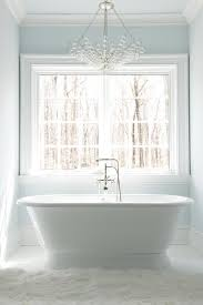 glass bubbles chandelier over roll top bathtub
