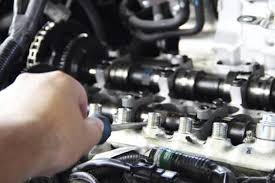 image of someone working on an engine