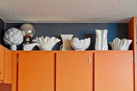 Kitchen Cabinet Shells Decorating Above Kitchen Cabinets Using White Ceramic With Shell