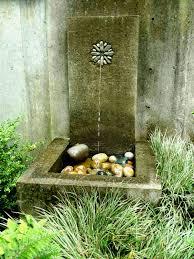 a simple cast concrete wall fountain in garden i built jeffrey bale s world of gardens