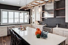 rustic pendant lighting kitchen transitional with counter chairs custom hoodfan image by trickle creek custom homes