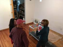 artists katy shanafelt l steven gossett and sara hill r setting up their work for the surel s place popup
