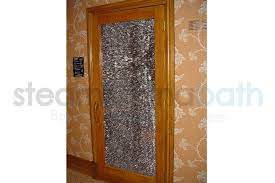 sauna door with shattered glass